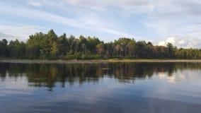 Enjoying Cottage Life. By the lake Stock Photography