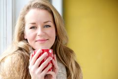 Enjoying a cup of coffee at home Royalty Free Stock Images