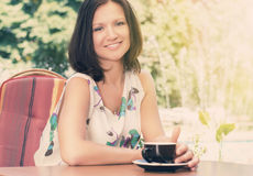 Enjoying a cup of coffee outdoors Royalty Free Stock Images