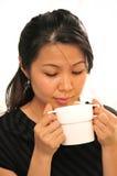 Enjoying a cup of tea. A young women enjoying a cup of tea royalty free stock image