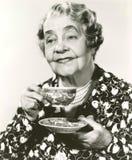 Enjoying a cup of tea Stock Photos