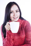 Enjoying cup of tea in studio. Beautiful woman is enjoying a cup of tea in studio royalty free stock image