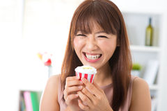 Enjoying cupcake Stock Image