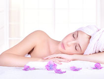 Enjoying day spa. Beautiful woman with closed eyes lying down on massage table, enjoying day spa, luxury beauty salon, healthy lifestyle Stock Photo