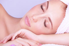 Enjoying day spa. Closeup portrait of beautiful woman with closed eyes lying down on massage table, enjoying day spa, healthy lifestyle, medical beauty salon Stock Image