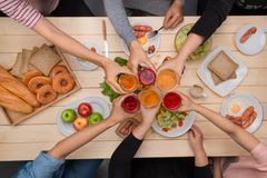 Enjoying dinner with friends.  Top view of group of people havin Stock Image