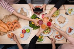 Enjoying dinner with friends. Top view of group of people havin royalty free stock images