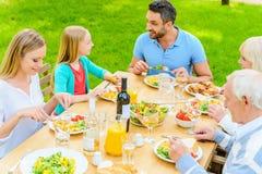 Enjoying dinner together. Stock Photos