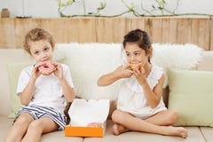 Enjoying doughnuts royalty free stock photos