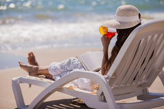 Enjoying a drink by the beach Royalty Free Stock Image