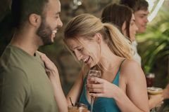 Enjoying Drinks In A Bar stock images