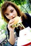Enjoying eating Fast food Royalty Free Stock Images