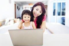 Enjoying entertainment on internet at home Royalty Free Stock Image