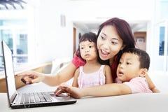 Enjoying entertainment on laptop at home royalty free stock image