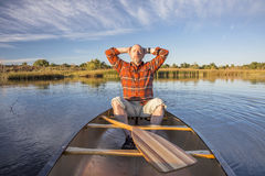 Enjoying evening canoe paddling Royalty Free Stock Photography