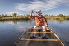 Enjoying evening canoe paddling Stock Images