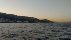 Sunset over the sea. Enjoying the evening sea on the boat and sunset in the Bosporus Strait stock image