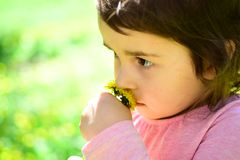 Enjoying every moment. Springtime. weather forecast. Little girl in sunny spring. face skincare. allergy to flowers. Summer girl fashion. Happy childhood royalty free stock image