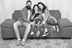Enjoying every moment together. bearded man and woman with child hold red heart. happy family at home on weekend. mother. Enjoying every moment together. bearded royalty free stock image