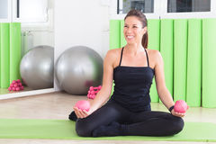 Enjoying exercise. Girl doing pilates in studio Royalty Free Stock Photos