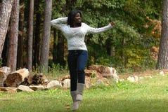 Enjoying a fall day. African american woman enjoying a beautiful fall day royalty free stock images