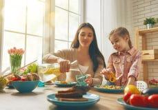 Enjoying family dinner Stock Images