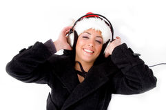 enjoying female headphone music Arkivbild