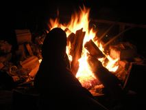 Enjoying the fire Royalty Free Stock Image
