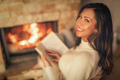 Enjoying By The Fireplace stock image