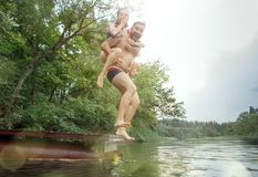 Enjoying river party with friends. Group of beautiful happy young people at the river together. Enjoying forest party with friends. Group of beautiful happy royalty free stock photos