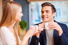 Enjoying fresh coffee together. Stock Images
