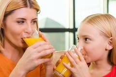 Enjoying fresh juice together. Stock Photos