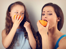 Enjoying fun young mother and cute long hair daughter holding an Royalty Free Stock Image