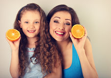 Enjoying fun young mother and cute long hair daughter holding sl Royalty Free Stock Photo