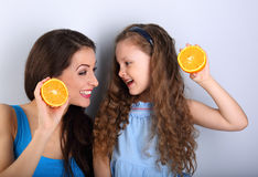 Enjoying fun young mother and cute long hair daughter holding sl Royalty Free Stock Photography