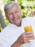 enjoying glass juice man senior Στοκ εικόνα με δικαίωμα ελεύθερης χρήσης