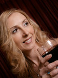 Enjoying a glass of red. Female enjoys a glass of red Royalty Free Stock Photos