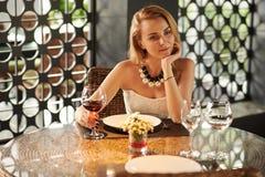 Enjoying glass of wine Stock Images