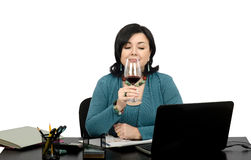 Enjoying a glass of wine while surfing favorite we Stock Image