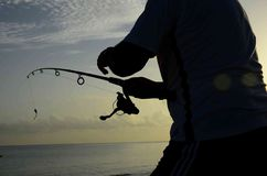 Enjoying. When we go on vacation and we have everything ready to spend the night fishing. Ready to fish royalty free stock photo