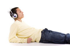 Enjoying good music. Young man lie down on the floor relaxing at the sound of good music Stock Photos
