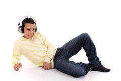 Enjoying good music. Young man relaxing at the sound of good music Stock Images