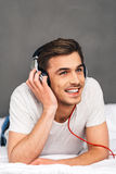 Enjoying good music in bed. Royalty Free Stock Photo