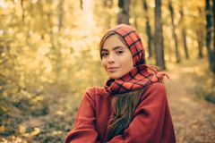 Enjoying good weather. Pretty woman walking in the Park and enjoying the beautiful autumn nature. cute girl in good mood. Posing in autumn day. Happy girl in stock image