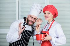 Enjoying happy moments. couple in love with perfect food. Family cooking in kitchen. secret ingredient by recipe. cook. Uniform. Menu planning. culinary cuisine stock photography