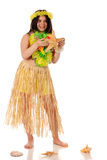 Enjoying Hawaii. A happy preteen girl in Hawaiian leis and grass shirt holding a large starfish.  Isolated on white Stock Image