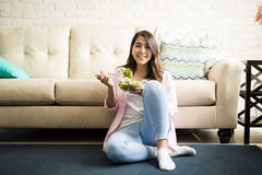Enjoying a healthy meal in the living room Stock Image