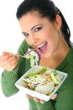 Enjoying Healthy Salad. Happy young woman enjoying her salad. healthy lifestyle stock images