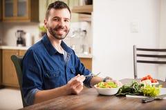 Enjoying a healthy salad at home Stock Images