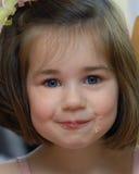 Enjoying her cake Stock Photography